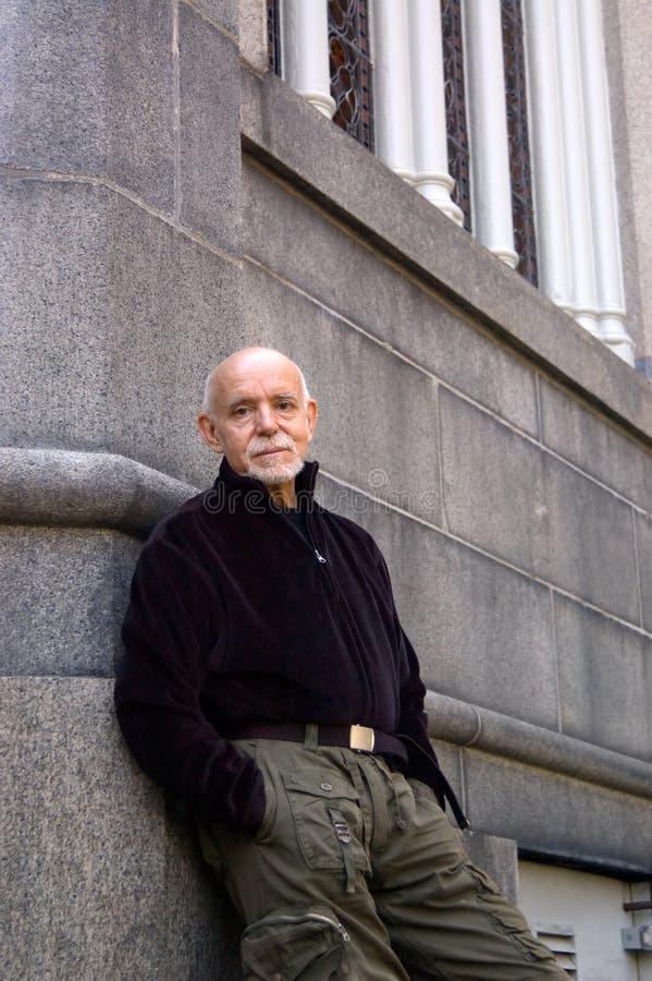 Older man leaning stock photos