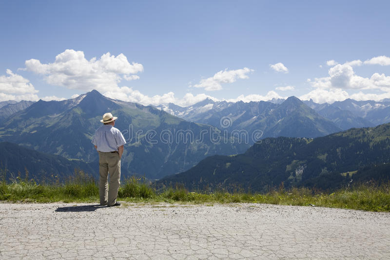 Older man overlooking the valley stock images