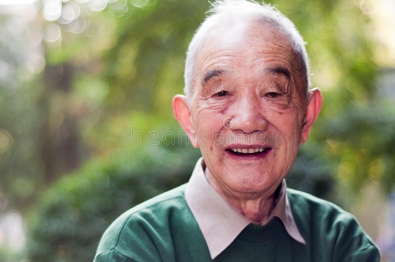 Older man portrait outdoor. A Chinese older man's portrait outdoor stock photo