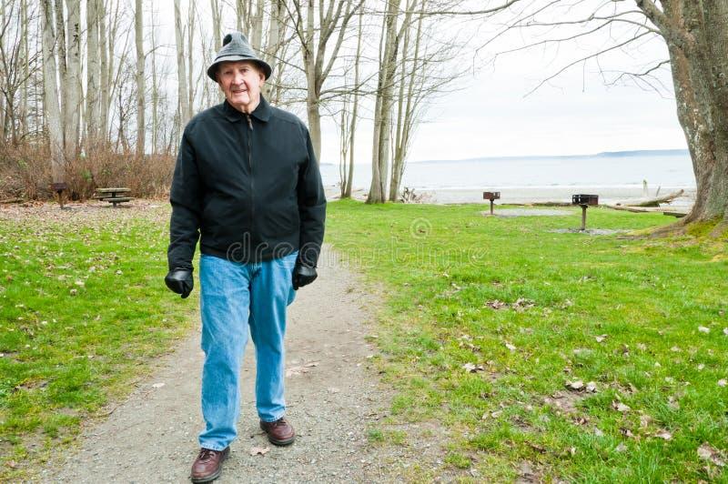 Older Man Walking in Park royalty free stock photo