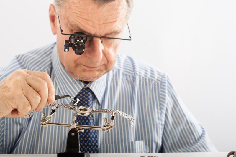 Older Man Repairing Watchmaker Stock Image