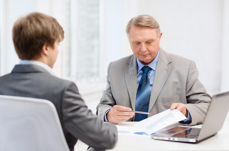 Download Older Man And Young Man Having Meeting In Office Stock Photo - Image of graphs, group: 36736748