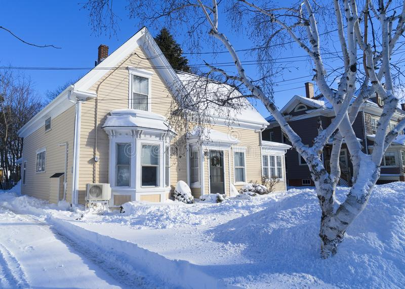 Older North American Home. Older traditional house in wintertime in a North American neighborhood stock photo