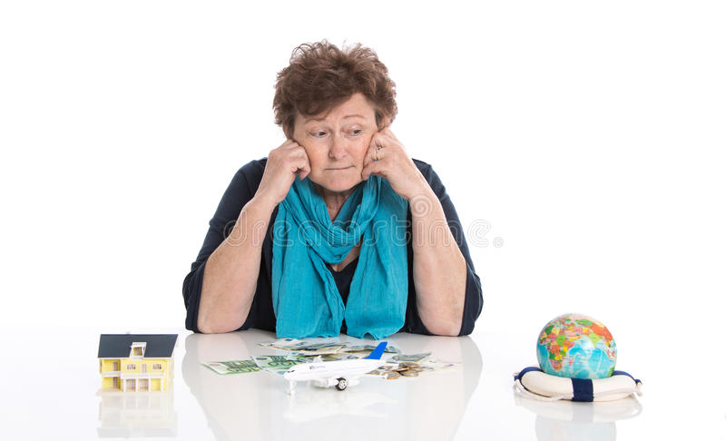 Older pensioner woman isolated over white dreaming of traveling. royalty free stock photo