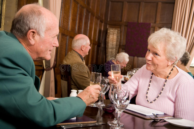 Older people celebrating together royalty free stock photography