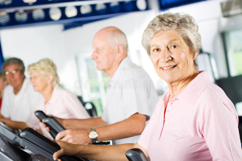 Older people exercising in the gym stock photos