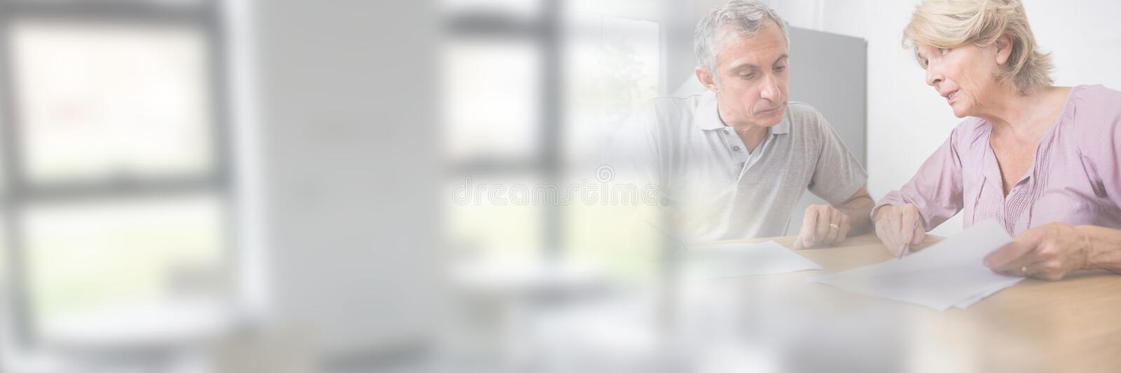 Older People Signing Paper Agreement with window transition stock photography