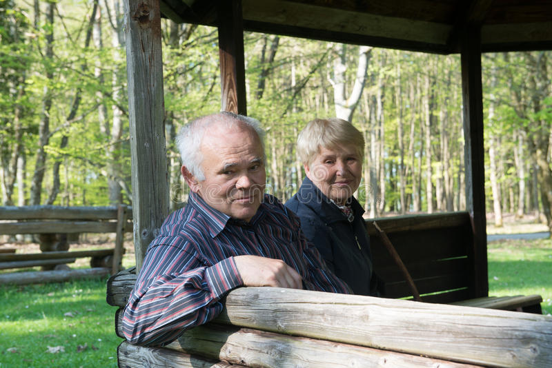 Older people sitting in the arbor royalty free stock photo