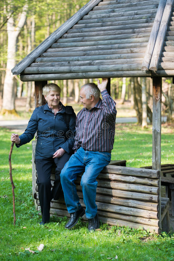 Older people sitting in the arbor stock images