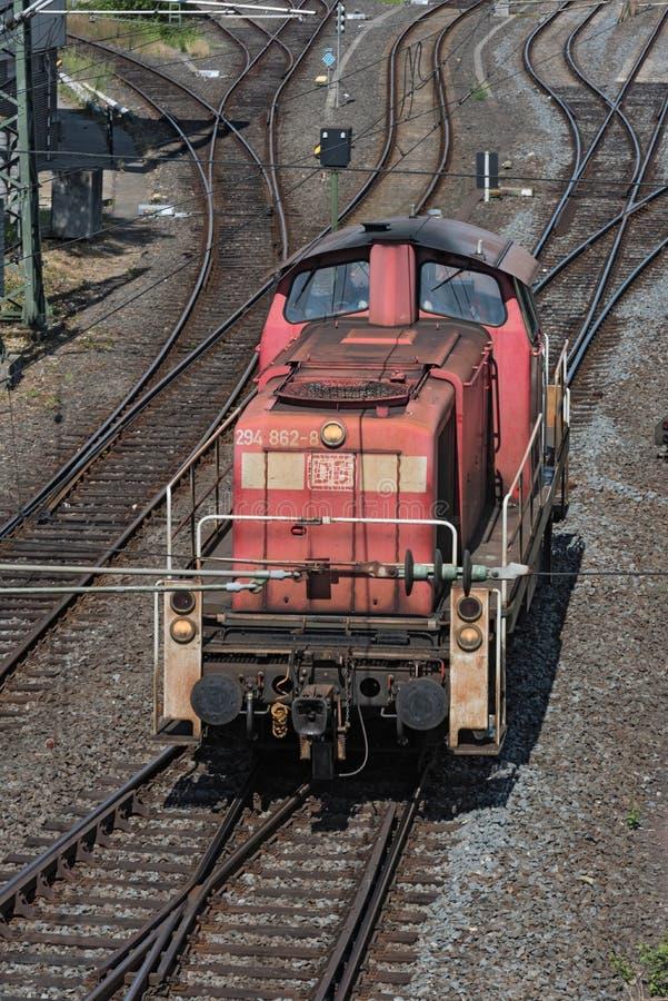 Older red diesel locomotive at the station stock image