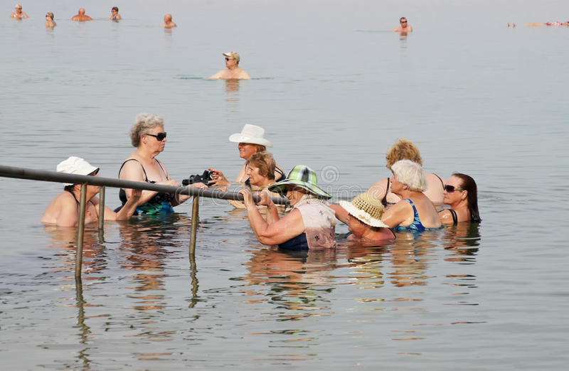 Older tourists bathe in the Dead Sea stock images