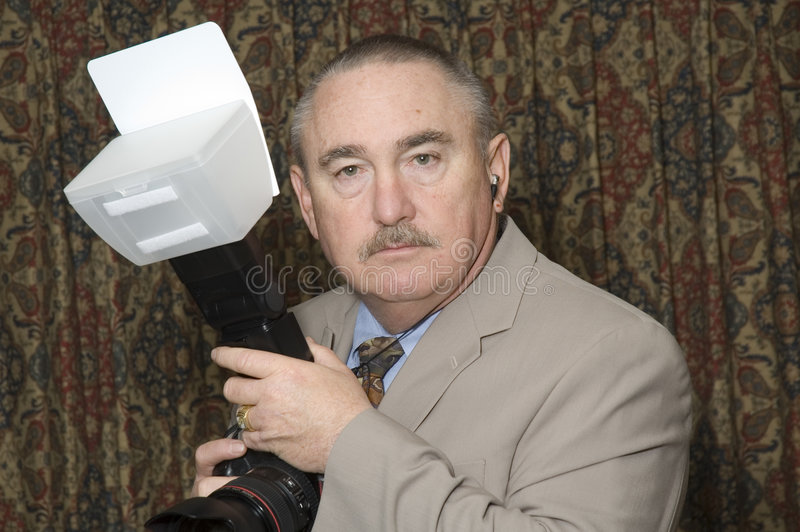 Older wedding photographer royalty free stock image