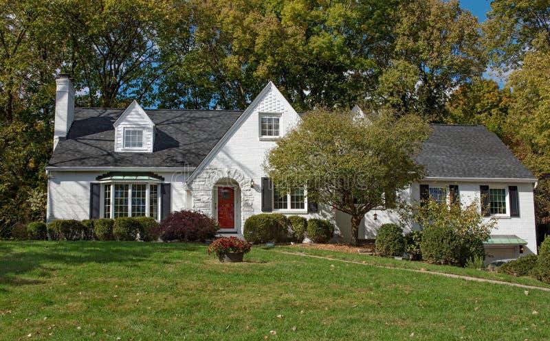 Older White Painted Brick House royalty free stock image