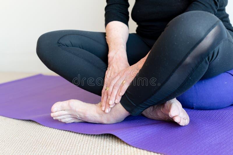 Older woman cross legged royalty free stock photos