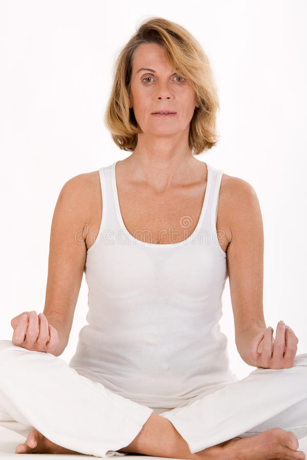 Download Older woman doing yoga stock photo. Image of belly, home - 22515290