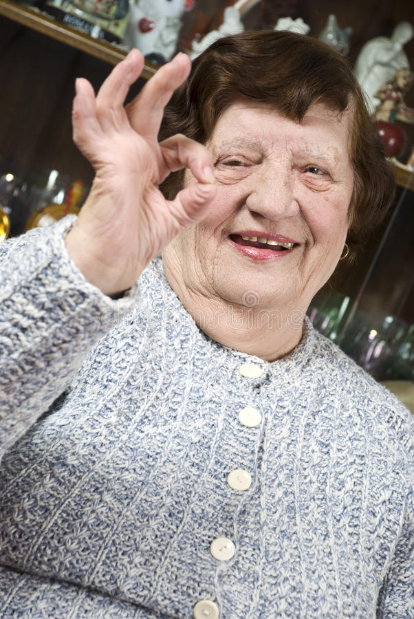 Older Woman Giving Okay Sign Royalty Free Stock Photography