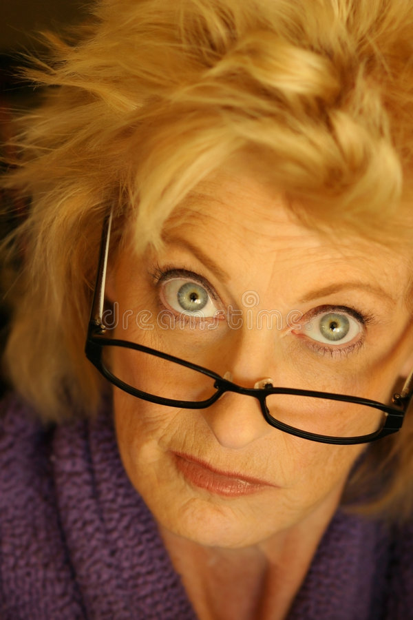 Older woman in glasses stock photos