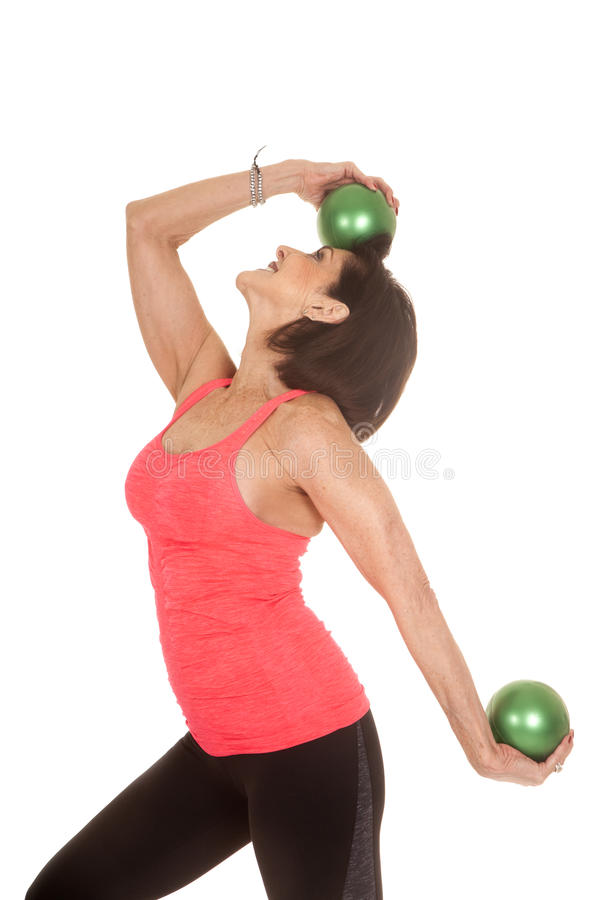 Older woman green balls fitness one on head royalty free stock photography