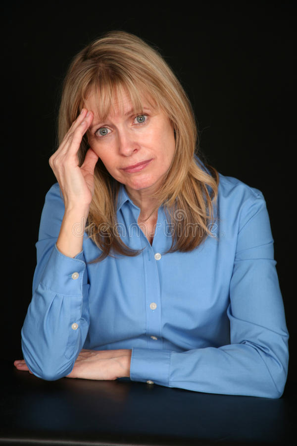 Download Older woman with headache stock photo. Image of alone - 14482174