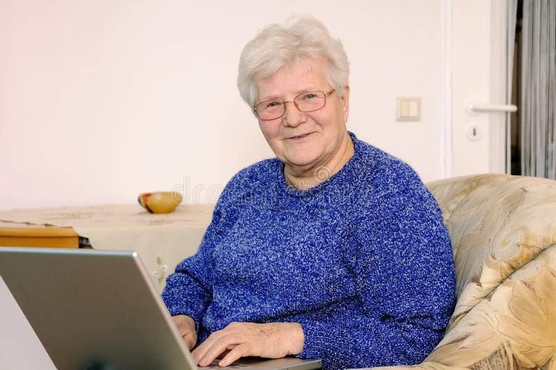 Download Older woman on laptop stock photo. Image of pensioner - 18148932