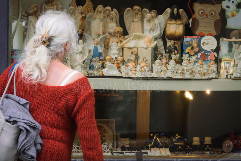 Window shopping for angel figurines royalty free stock images