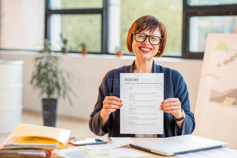 Older woman with resume stock photo