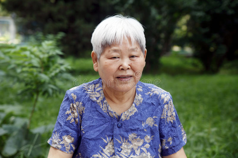 Older woman's portrait outdoor. A Chinese older woman's portrait outdoor stock image