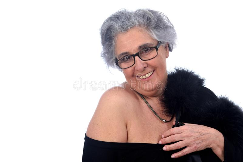 An older woman with a posed on white background. Older woman with a posed on white background royalty free stock images