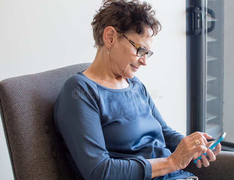 Older woman with smart phone royalty free stock photos