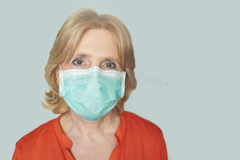 Older woman with surgical mask royalty free stock photos