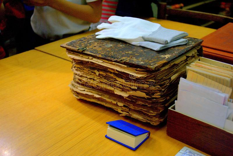 The oldest copy of the Bible from the repository of the Central Autograd Library lies next to the new edition in a pocket version. Tolyatti, Samara Region royalty free stock photography