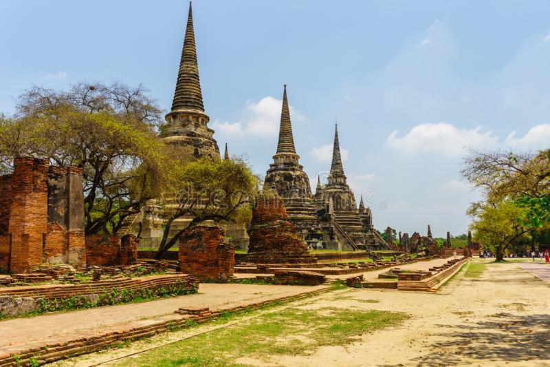 The oldest and most beautiful pagoda in Ayutthaya.among trees. The oldest and most beautiful pagoda at has hat in Ayutthaya among trees royalty free stock photo