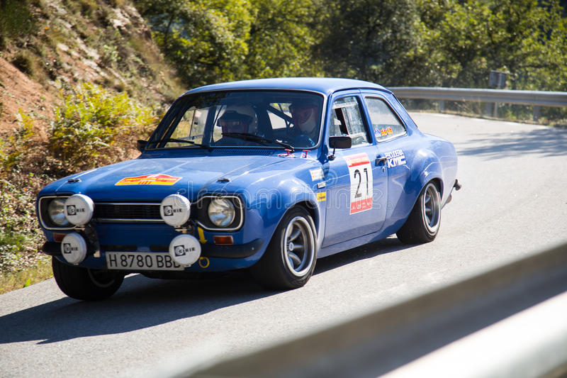 The oldest rally in spain. Vic, SPAIN - OCTOBER 12 : Spanish driver Manel Perez and his codriver in a Ford Escort MKI race in the 61nd Rally Costa Brava, on royalty free stock image