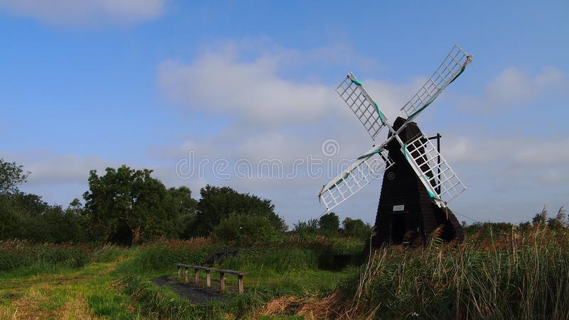 Windmill at Wicken Fen, England. The oldest working wooden windpump at Wicken Fen in Cambridgeshire, Great Britain royalty free stock photography
