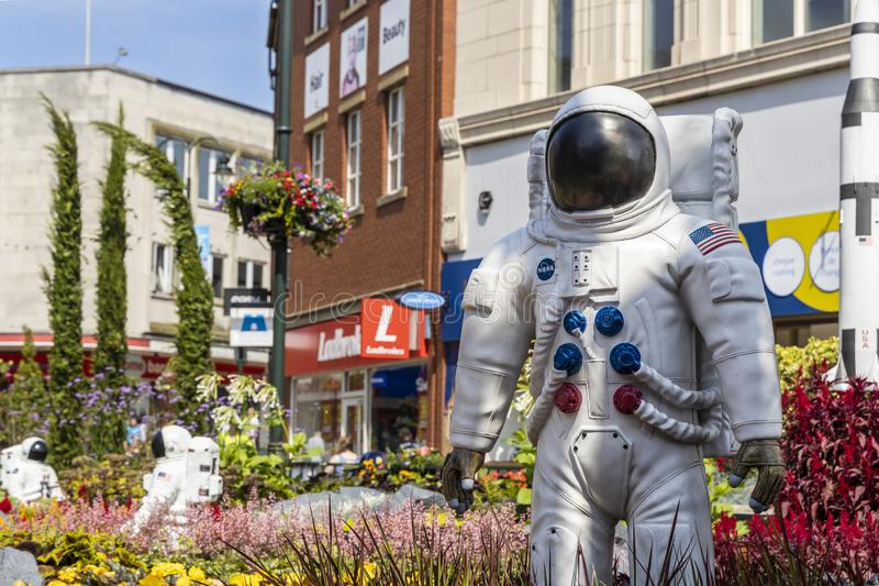 Urban garden design commemorating Landing on The Moon. OLDHAM, LANCASHIRE, UK - July 25, 2019: Alien landscape with American astronauts landing on the Moon royalty free stock images