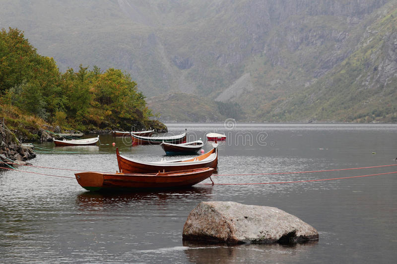 Oldies but goldies in Lofoten. Traditional Lofotens boat in a calm fjord of Moskenes island royalty free stock image