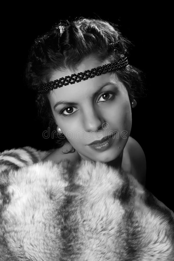 Oldies movie star with fur. Glamour style vintage 1920 actress posing like a diva stock image