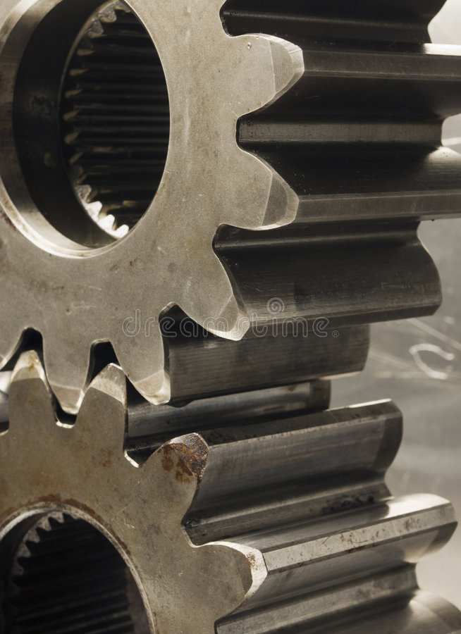 Oldish look of gear-wheels in brown stock photo