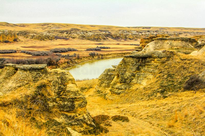Oldman river flowing through the badlands stock photo