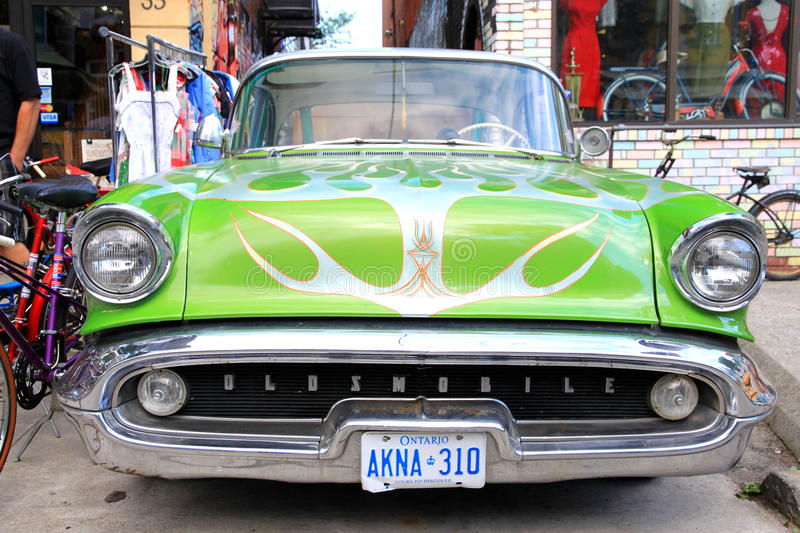 Oldsmobile. A green Oldsmobile parked in the streets of Toronto, Canada royalty free stock images