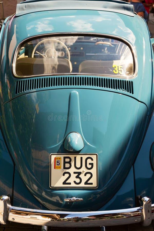 Oldsmobile Veteran Weinleseauto Volkswagen Beetles stockfotos