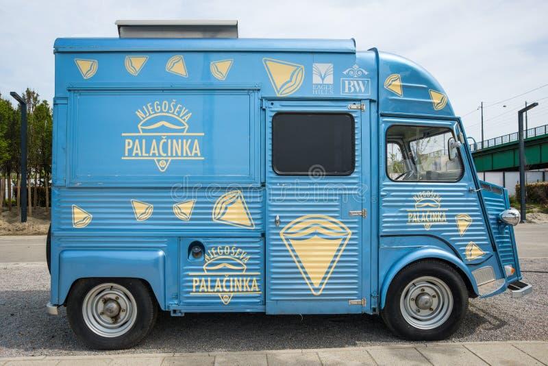 Oldtimer food truck on the street of Belgrade. Old vintage van. royalty free stock image