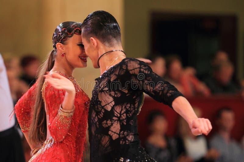 Olga Voronina and Dmitry Bayanov - latin ballroom dancing stock photography