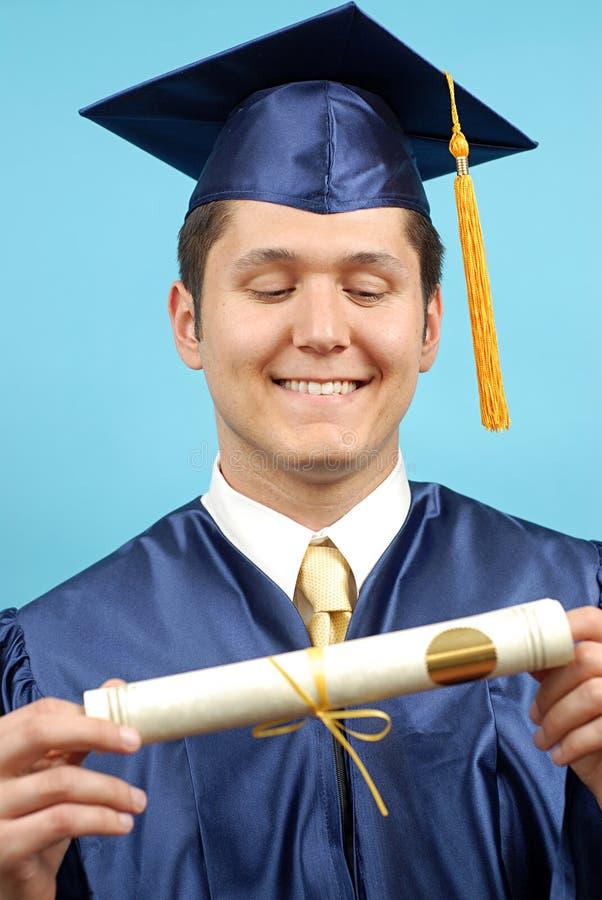 Olhando o diploma novo imagens de stock
