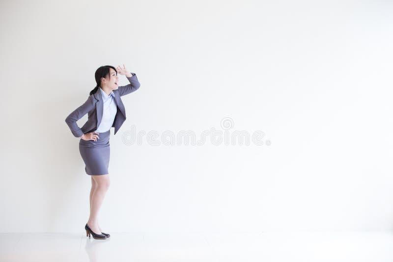 Olhar da mulher de negócio algo imagens de stock