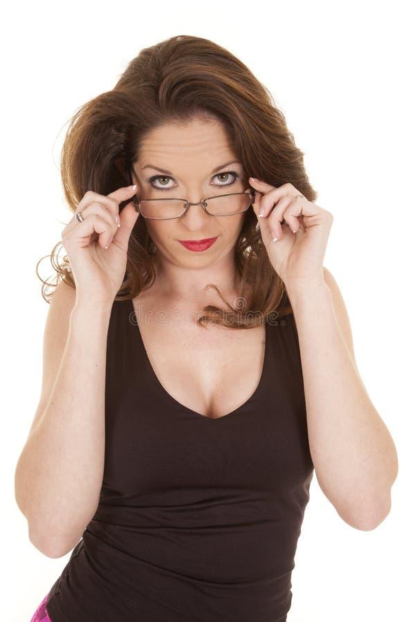 Olhar da mulher sobre vidros fotografia de stock royalty free