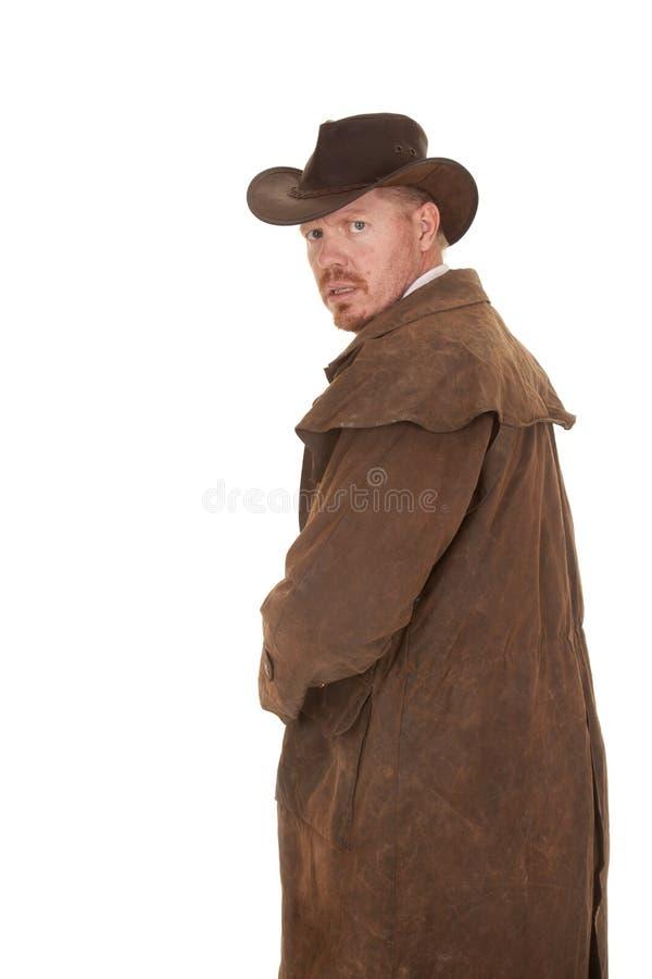 Olhar de couro do espanador do vaqueiro para trás receoso foto de stock royalty free