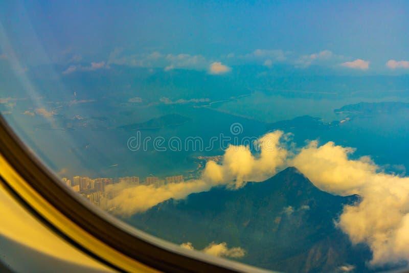 Olhe a janela no avião imagens de stock royalty free