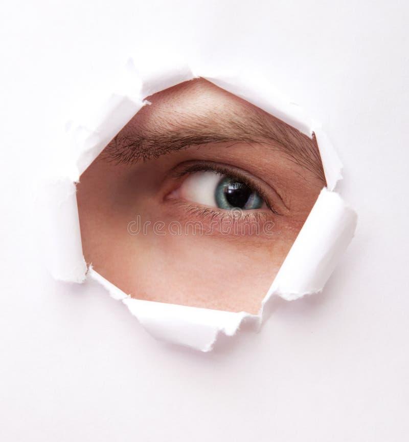 Olho do furo de papel fotografia de stock