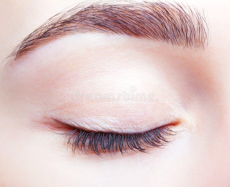 Olho e testas fechados fêmeas com composição do dia fotos de stock royalty free